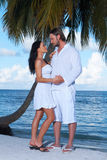 Couple nex to Palm tree Royalty Free Stock Image