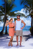 Couple nex to Palm tree Stock Photo