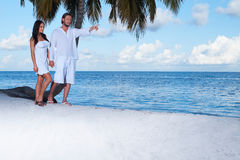 Couple nex to Palm tree Royalty Free Stock Photo