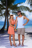 Couple nex to Palm tree Royalty Free Stock Photos