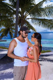 Couple nex to Palm tree Stock Photography