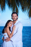 Couple nex to Palm tree Stock Photos