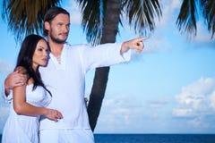 Couple nex to Palm tree Royalty Free Stock Photos