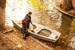 Couple next to a boat in park. Romance and love Royalty Free Stock Photo