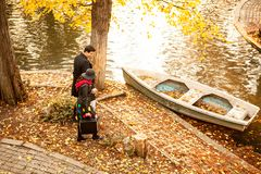 Couple next to a boat in park. Romance and love Royalty Free Stock Photography