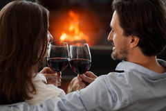 Couple next to the fireplace Royalty Free Stock Photo