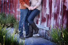 Couple Next to Old Barn Holding Hands Stock Photo