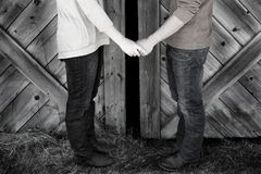 Couple Next to Old Barn Holding Hands Royalty Free Stock Photography
