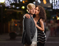 Couple in night city. Young couple portrait on the night city background Stock Photo