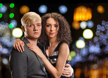 Couple in night city. Young couple portrait on the night city background Stock Image