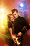 Couple in the night club. Happy couple in the night club Royalty Free Stock Photo