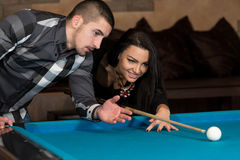 Couple In A Nightclub Playing Pool Royalty Free Stock Image