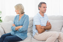 Couple not taking after a fight. At home on couch stock photo