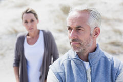 Couple not talking after argument on the beach Stock Image