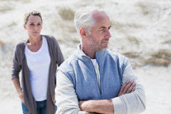 Couple not talking after argument on the beach Stock Photography