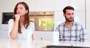 Couple not talking after an argument in kitchen. At home stock video