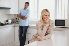 Couple not talking after an argument in kitchen Stock Photography
