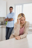 Couple not talking after an argument in kitchen Royalty Free Stock Photography