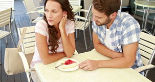 Couple not talking after an argument. In a restaurant stock footage