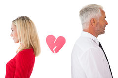 Couple not talking with broken heart between them Royalty Free Stock Photo