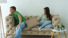 Couple not talking after a dispute on the sofa stock footage