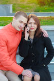 Couple not talking to each other typing on mobile phones. Smile Stock Photography
