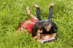 Couple with notebook Stock Photography
