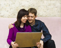 Couple with notebook Royalty Free Stock Image