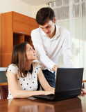 Couple  with notebook at home Stock Image