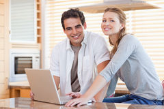 Couple with notebook in the kitchen Royalty Free Stock Images