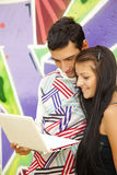 Couple with notebook near graffiti wall. Stock Images