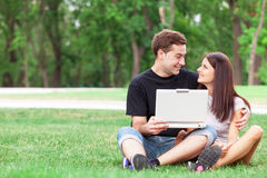 Couple with notebook Stock Photos