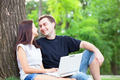 Couple with notebook Stock Images