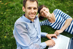 Couple with notebook Stock Photo