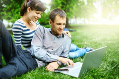 Couple with notebook Royalty Free Stock Photo