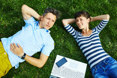 Couple with notebook Royalty Free Stock Images
