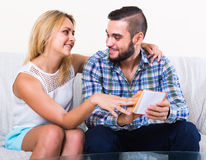 Couple with notepad at home Stock Image