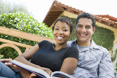 Couple With Novel Smiling Royalty Free Stock Photos