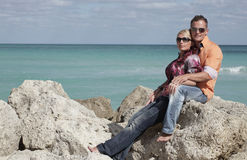 Couple on a ocean background Royalty Free Stock Image