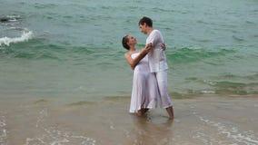 Couple in ocean stock video