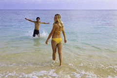Couple in the ocean in hawaii Stock Photos