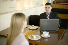 Couple Of Business People At The Table Royalty Free Stock Images