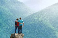 Free Couple Of Hikers Standing Embraced On The Cliff Edge And Enjoying Beautiful Morning View In The Mountains Stock Photography - 118337642