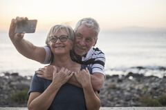 Free Couple Of Seniors Taking A Salfie At The Beach - Hapy Married Retired Couple Enjoying - Woman With Glasses Royalty Free Stock Images - 191686589