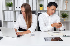 Couple of office workers in action Stock Photography