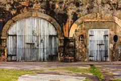 Two old cellar doors. A couple of old cellar doors in San Juan close to the fortress Castilo San Felipe del Morro Royalty Free Stock Photography