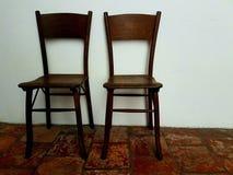 The Couple of old chairs. The couple old chairs in on old floor Stock Photo