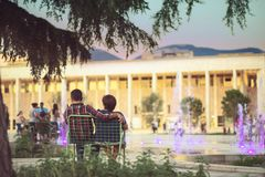 Couple in. Old couple enjoying the evening city in Tirana center at newly rebuilt Skanderbeg Square Royalty Free Stock Photo