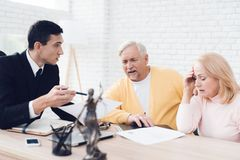 A couple of old people came to see a realtor. The old man and the woman are very upset. A couple of old people came to see a realtor. The old men and the women royalty free stock images