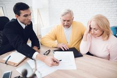 A couple of old people came to see a realtor. The old man and the woman are very upset. A couple of old people came to see a realtor. The old men and the women stock image